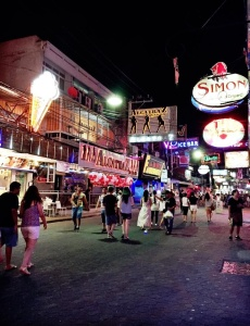 """Hundreds of neon signs along Pattaya's Walking Street invite tourists into bars and clubs. However, much different signs exist just off of Walking Street. They read: """"No Durian, No Dog, No Lady Boy."""" Durian is fruit known for its unpleasant odor. Image by Julia Boccagno. Thailand, 2015."""