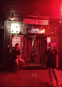 """Managers of go-go bars keep a close eye on internal operations, ensuring a customer pays a """"bar fine"""" before taking an escort out. Ranging from 600 – 1,000 baht ($17 - $28), the money usually goes exclusively to the bar—not the escort. Image by Julia Boccagno. Thailand, 2015."""